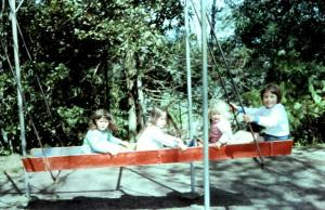 Jacque, Kelly, Clifton and David on the boat swing (now banned) 1975.